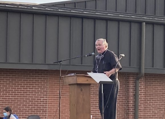 Father Dan Noll speaks at the 2021 BUILD Nehemiah Action at Mary Queen of the Holy Rosary in Lexington.